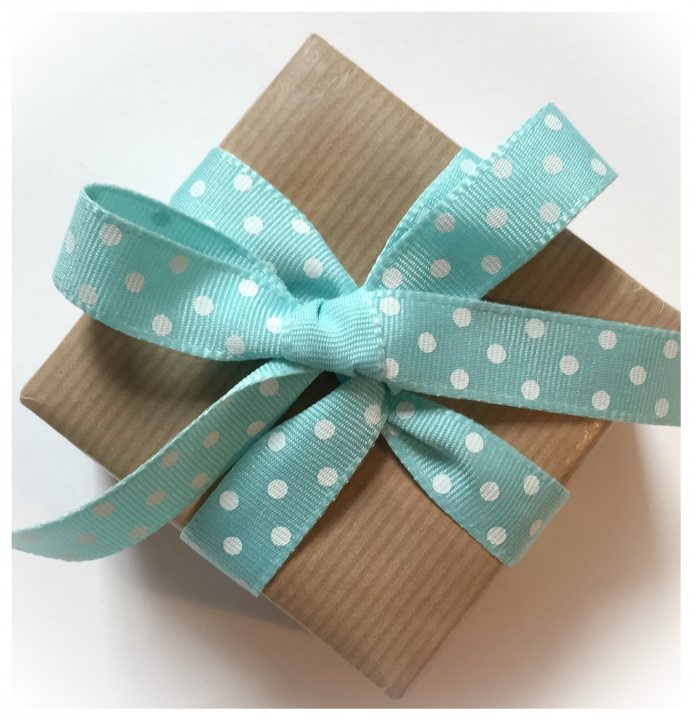 Brown Kraft paper wrapping with turquoise and white dotty Jane Means Ribbon