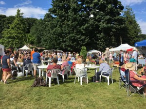 Lots of people enjoying the sunshine on the lawn at Thornborough Hall, on day one of the Home Front Vintage Fair in Leyburn