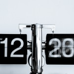 Digital clock, the minutes spinning and the clock hanging from a balance