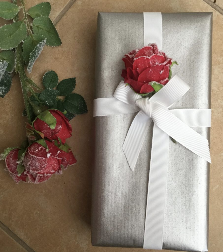 Silver wrapped parcel with white grosgrain ribbon and rose embellishment!