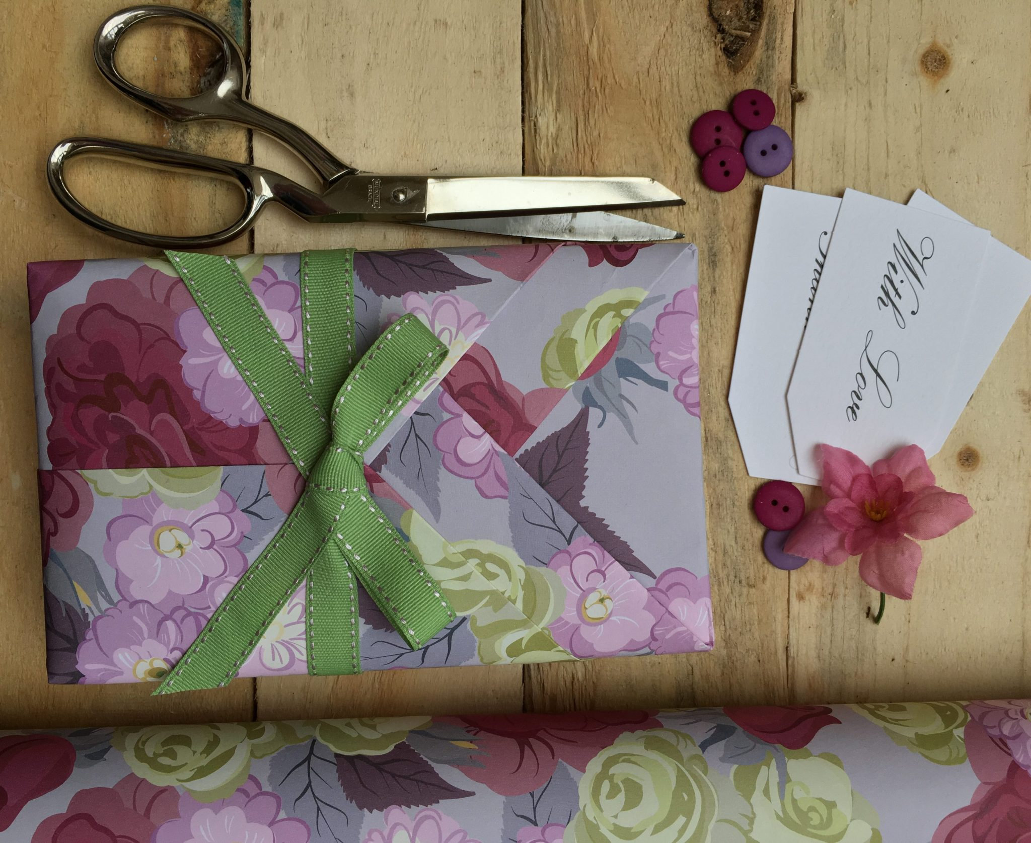 kimono style wrapped parcel, roll of giftwrap, scissors and tags