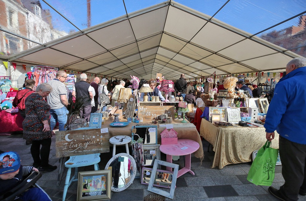 Stallholders and customers inside the marquee