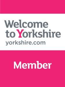 Cerise pink & silver plaque saying Welcome to Yorkshire Member