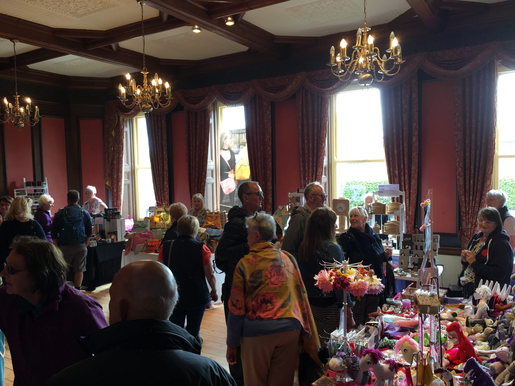 Inside the Oak Room, with trader stalls set up for the Craft & Gift Fair at the Dales Festival of Food & Drink, Leyburn
