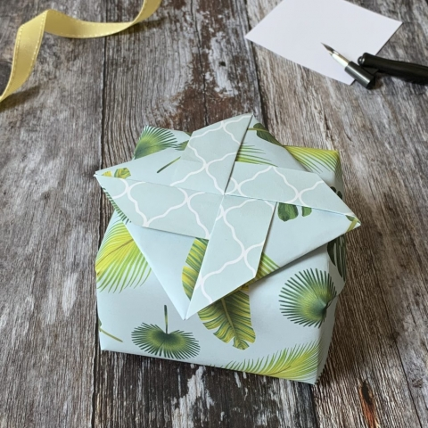 A giftwrapped box with a secret message section