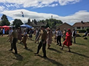 Home Front Vintage Fair - Ladies & gentlemen dancing on the lawn in 1940's clothing