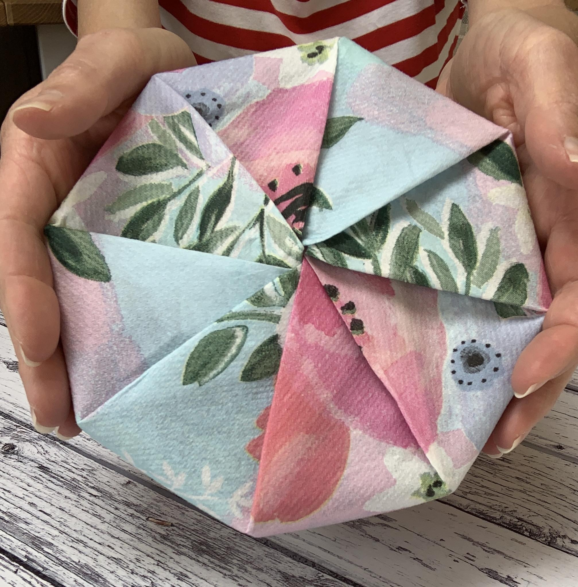 8 sided box of chocolates wrapped in a floral giftwrap