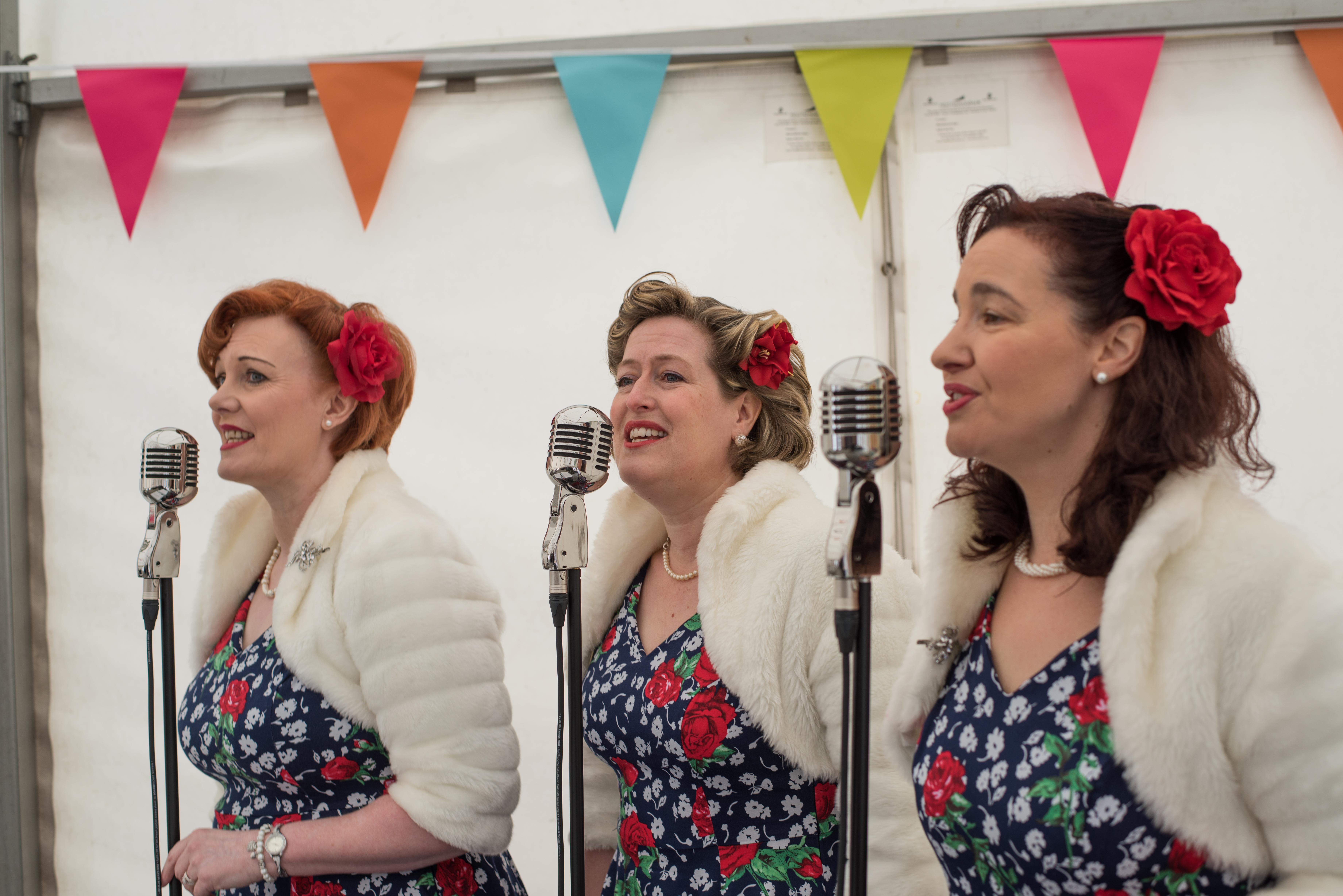 The close harmony trio singing at Stockton Chic Vintique 6th April
