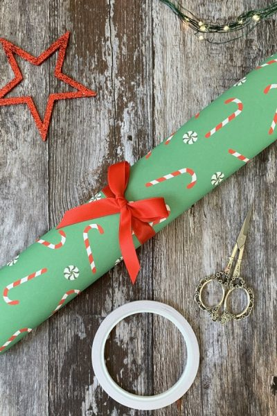 Roll of gift Wrap ties with a red ribbon